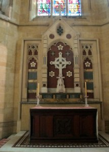 Altar of Lady Chapel. Lily themed kneelers visible in lower left corner