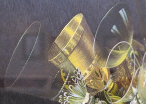 A close-up of a still life by Margaret Lee. Look at the exquisite stitch quality on the glass ware